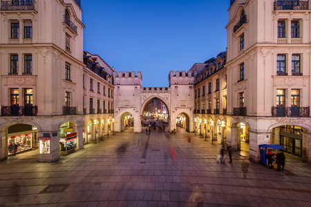 Karlstor Gate and Karlsplatz Square in the Evening, Munich, Germany Фото со стока