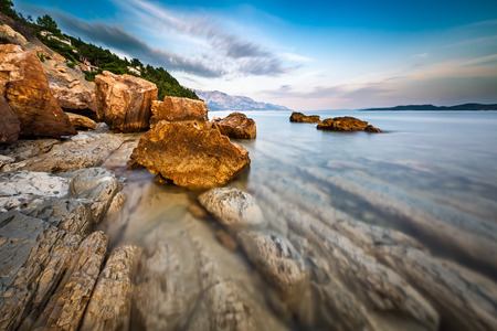 adriatic: Rocky Beach and Transparent Adriatic Sea near Omis in the Evening, Dalmatia, Croatia Stock Photo