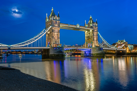 Tower Bridge and Thames River Lit by Moonlight at the Evening, London, United Kingdom Фото со стока