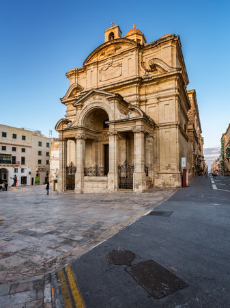 evening church: Saint Catherine of Italy Church and Jean Vallette Pjazza in the Evening, Vallette, Malta Stock Photo
