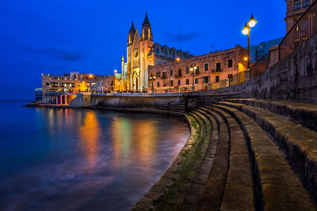 julian: Church of Our Lady of Mount Carmel and Balluta Bay in Saint Julien, Malta
