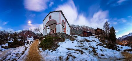 zermatt: White Church on the Hill and Matterhorn Peak before Dawn, Zermatt, Switzerland