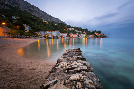 croatia: Beautiful Adriatic Beach and Mimice Village on Omis Riviera in the Evening Dalmatia Croatia