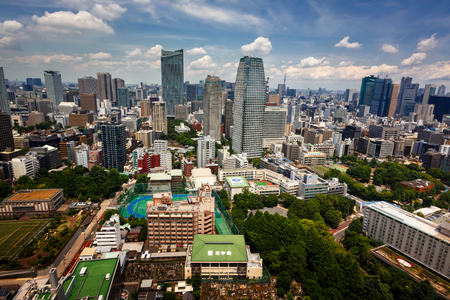 well known: TOKYO, JAPAN - JUNE 10: View at modern skyscrapers in Roppongi district in Minato, Tokyo at June 10, 2015. This district is well known as the citys most popular nightlife district.