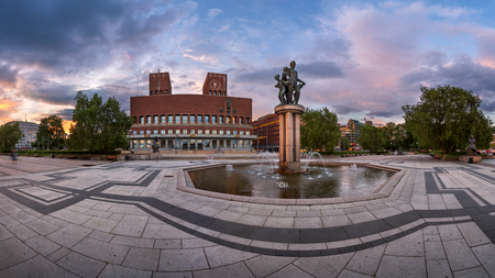 guildhall: OSLO, NORWAY - JUNE 12, 2014: Oslo City Hall in the Evening. The construction started in 1931, but was paused by the outbreak of World War II, before the official inauguration in 1950. Editorial