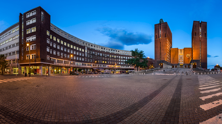 OSLO, NORWAY - June 11, 2014: Panorama of Oslo City Hall. The construction started in 1931, but was paused by the outbreak of World War II, before the official inauguration in 1950.