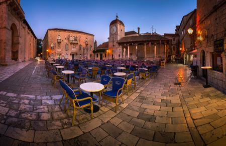 3rd century: TROGIR, CROATIA - SEPTEMBER 28, 2015: Saint Sebastian Church and Trg Ivana Pavla II in Trogir, Croatia. Trogir was founded in the 3rd century BC, by Greek colonists from the island of Vis. Editorial