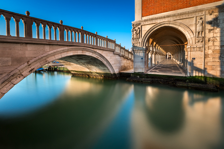 Bridge, Canal and Doges Palace Illuminated by Rising Sun at Sunrise, Venice, Italy