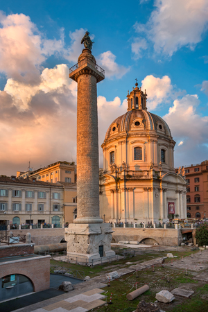 metres: ROME, ITALY - 1 NOVEMBER 2013: Trajans Column and Santa Maria di Loreto Church in Rome. The structure is about 30 metres in height and 35 metres including its large pedestal.