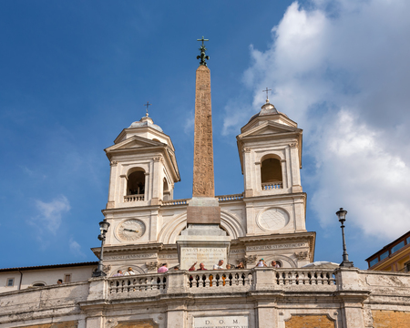 ROME - OCTOBER 31, 2013: Trinita dei Monti Church on top of Spanish Steps in Rome, Italy. With 138 steps in total, the Spanish Steps of Rome are the longest and widest outdoor steps in Europe.