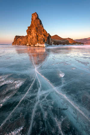 Famous Baikal Lake Ice and Island Oltrek at Sunrise, Baikal Lake, Russia Stock Photo