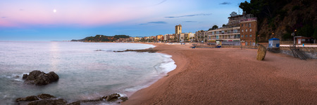 seafronts: LLORET DE MAR, SPAIN - JUNE 21, 2016: Panorama of Lloret de Mar Seafront in Catalonia, Spain. Lloret de Mar is most popular Costa Brava resort and located only 75 km from Barcelona.