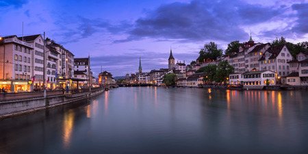 grossmunster cathedral: ZURICH, SWITZELAND - 04 June, 2016: Zurich Skyline and Limmat River. The river commences at the outfall of Lake Zurich, in the centre of the city of Zurich. Editorial