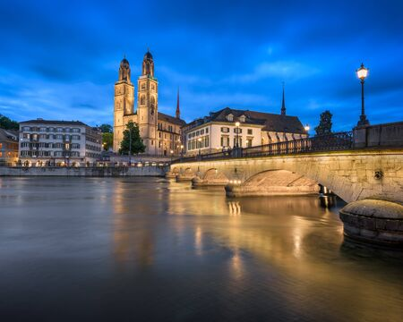 grossmunster cathedral: Grossmunster Church and Limmat River in the Evening, Zurich, Switzerland