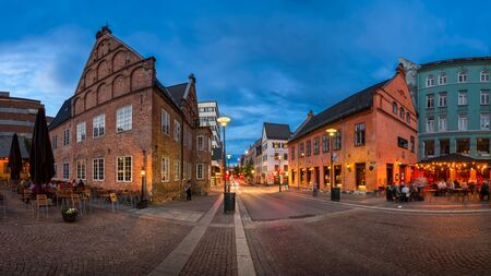 iv: OSLO, NORWAY - JUNE 12, 2014: Christiania Torv in the Evening. King Christian IV decided to rebuild the city after fire in 1624. He pointed to this spot and said - the new town will lie here!