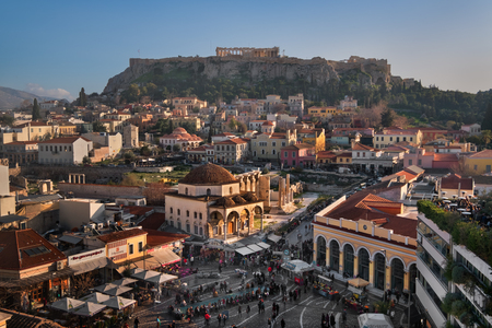 ATHENS, GREECE - FEBRUARY 24, 2017: Aerial View of Monastiraki Square and Acropolis in the Evening, Athens, Greece. Monastiraki is a flea market neighborhood in the old town of Athens. Редакционное