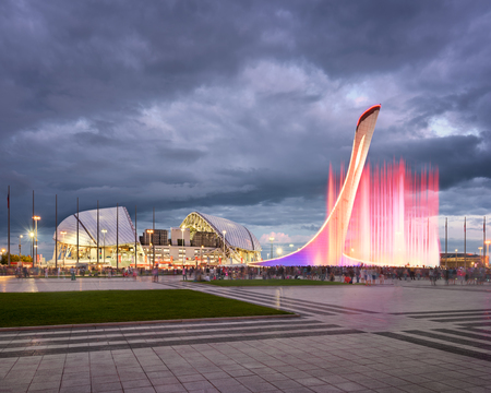 SOCHI, RUSSIA - JUNE 20, 2017: Music Fountain and Olympic Stadium Fisht in the Evening, Sochi, Russia. Named after Mount Fisht, the 40,000-capacity stadium was constructed for the 2014 Winter Olympics. Редакционное