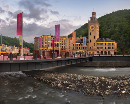 SOCHI, RUSSIA - JUNE 22, 2017: Romanov Bridge and Mzymta River in the Morning, Rosa Khutor, Sochi, Russia. Rosa Khutor constructed from 2003 to 2011 and hosted the alpine skiing events for the 2014 Winter Olympics.