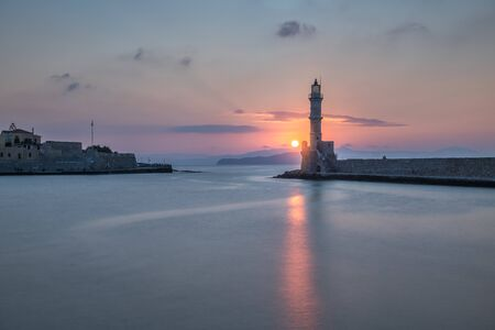 Lighthouse and Old Venetian Port in Chania at Sunset, Crete, Greece 写真素材