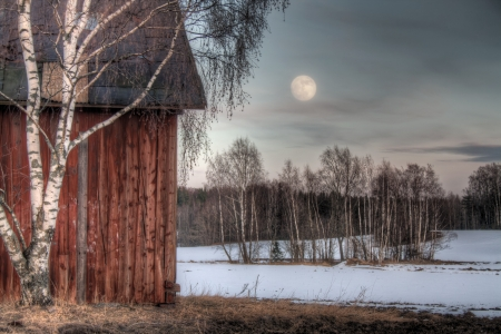 old barn in winter: Old red barn in a countryside landscape with full moon Stock Photo