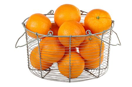 Oranges in a basket isolated on white photo