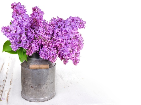 Lilacs on a rustic wooden background photo