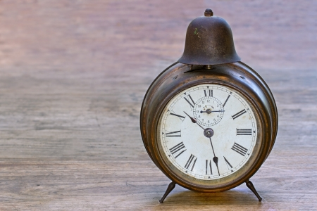 Antique brown clock on a wooden background Stock Photo - 14412199