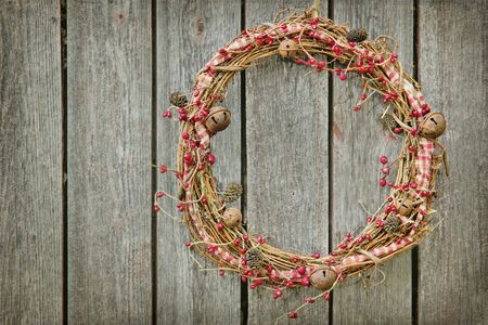 Christmas wreath hanging on a wooden rustic vintage background with copy space photo
