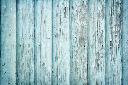 Old wooden painted light blue rustic background, paint peeling photo