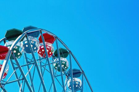 theme parks: Closeup of a colorful ferris wheel with cloudless blue sky