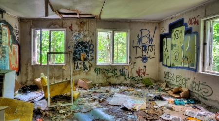 Abandoned, messy and trashed house interior with graffifi on walls Stock Photo