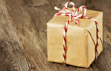 Christmas style rustic brown paper package tied up with strings