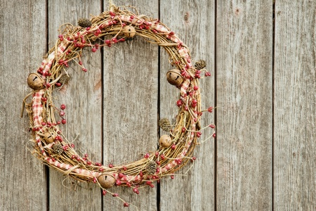 Rustic Christmas wreath hanging on a wooden vintage background with copy space Stock Photo - 15226820