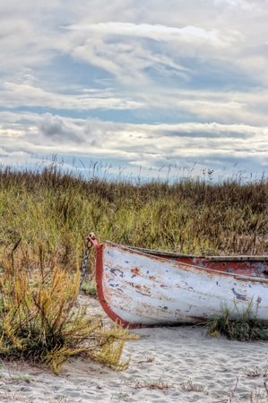 Rusty old abandoned boat at beach photo