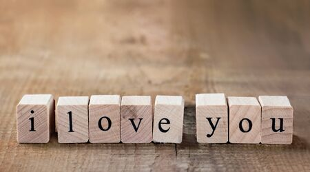 love message: Message I love you spelled in wooden blocks with copy space