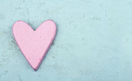 Single pink heart on light blue wooden table - shabby chic Valentines day background Stock Photo