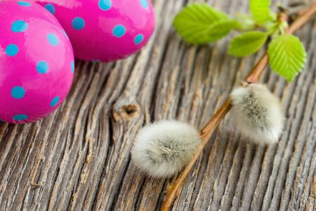 pink pussy: Easter decoration - pink eggs and pussy willow - on rustic wooden background Stock Photo