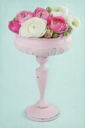 Flowers in an elegant pink tall vase on light blue textured background Stock Photo - 17974761