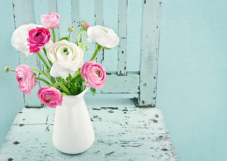 antique vase: White and pink flowers on light blue vintage chair Stock Photo