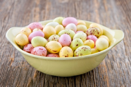 Yellow small easter eggs on a wooden rustic background photo