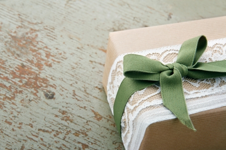 Decorative Gift Box Wrapped In Brown Eco Paper White Lace And Green Bow On Wooden