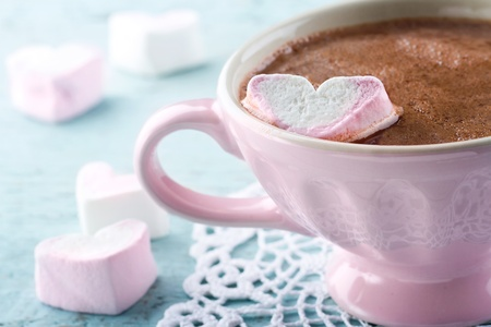Hot chocolate and a heart shaped marsmallow in a vintage pink cup