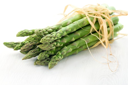 Fresh asparagus closeup on white wooden background Stock Photo