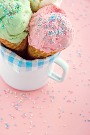 Ice cream cones in an old mug in pink shabby chic vintage background Stock Photo - 19264094