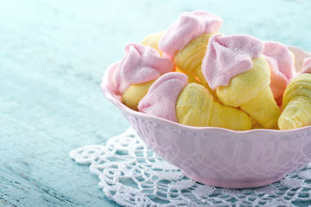 Sugary pink marshmallows shaped like ice cream in a bowl on blue vintage wooden background Stock Photo - 19264325
