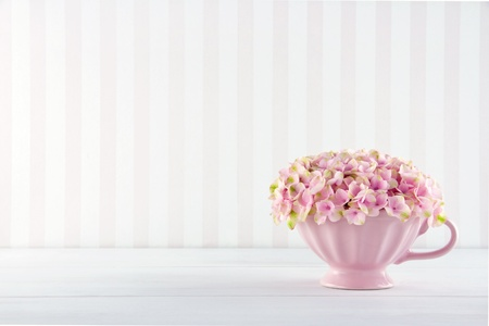 hydrangea: Pink hydrangea flowers in a shabby chic mug on vintage background with copy space Stock Photo