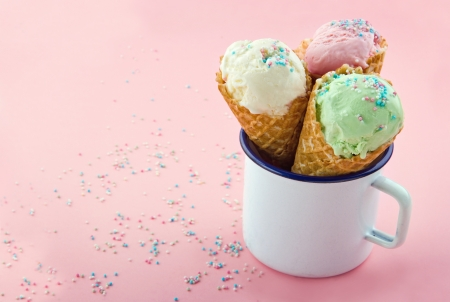 Ice cream cones with sprinkles on pink background and copy space Stock Photo - 19541437