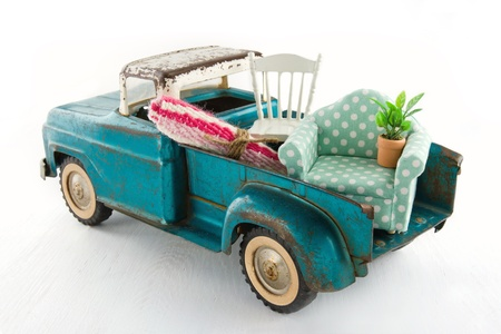Old vintage toy truck packed with furniture - moving houses concept Banco de Imagens - 19979130