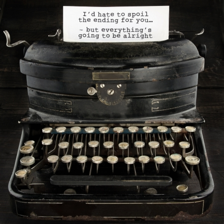 Old antique black vintage typewriter and paper with text telling everthing is going to be alright - concept for optimism, comfort and trust for the future