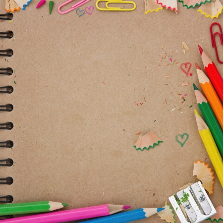 colored pencil: Back to school background with brown recycled paper notebook and colorful wooden pencils